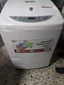 Lavadora lg 28 libras en muy buen estado