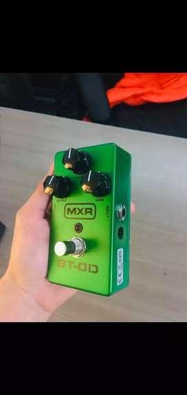 Cargador adaptador para pedales y Pedal overdrive para guitarra