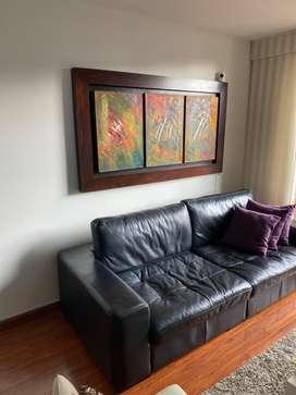 Sofá negro cuero