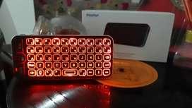 Pazzpart  teclado  retroiluminado  a bluetooth   para  celular  tv   y  tablets   con mouse incorporado