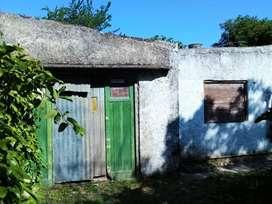 Vendo terreno 10x33 con casa 4 ambiente y garage