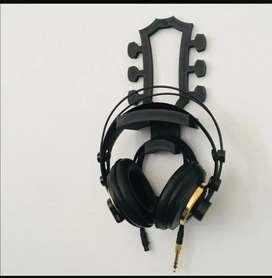 Soporte para audifonos con forma de clavijero