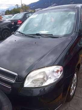 Auto marca Chevrolet, color negro, modelo Aveo emotion, año 2010