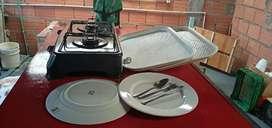 vendo estufa, bandejas, platos y cubiertos
