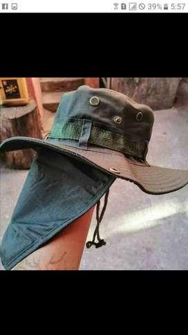 Sombrero de algodón con protección de cuello y broches en alas laterales. Color verde. Abano. Café Azul negr Precio $10