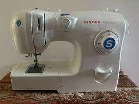 Vendo máquina de coser marca  singer