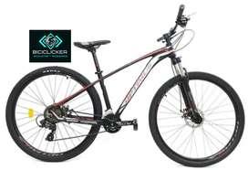 Bicicleta Optimus Akila rojo negra grupo Shimano biplato de 8 velocidades rin 29, freno de disco hidráulico.