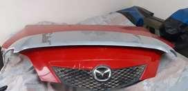 Capot y alerón Mazda demio y Mitsubishi