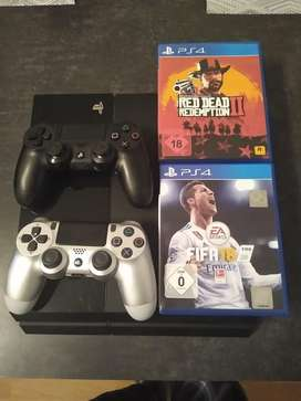 Ps4 o playstation 4 con dos controles RDR 2 y fifa 18