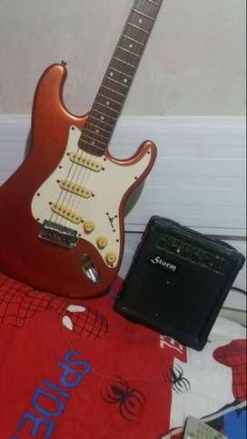 Guitarra eléctrica con amplificador.