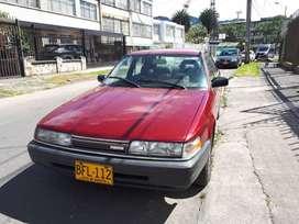 Mazda 626L 1995 2000cc 75300km full equipo perfectas condiciones. rojo pasion, A/A, bloqueo, alarma, elevavidrios, cuero