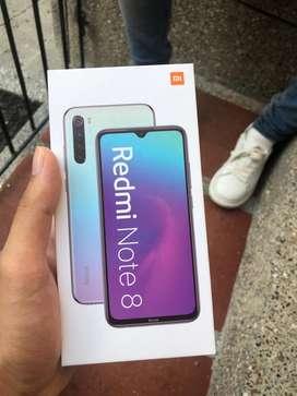 Celular xiaomi Redmi note 8 en su caja