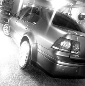 Vendo bora 1.8 turbo automático c/cuero y nogal caja de 6ta