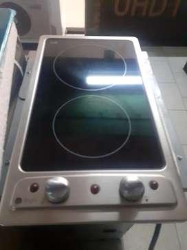 Vendo estufa de 2 puestos vitrocerámica General Electric buen estado