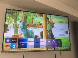 Television smart tv de 48 pulgadas como nuevo con soporte de brazo