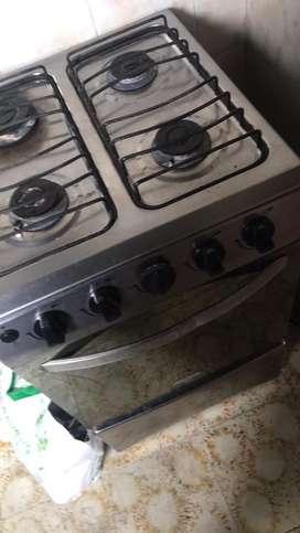 Vendo estufa con horno a gas ganda