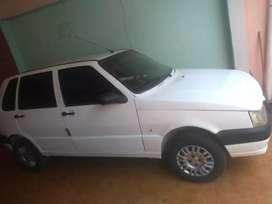 Vendo Fiat uno impecable con A/C NUNCA TAXI