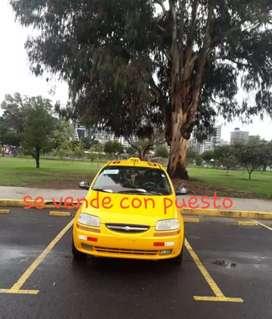 Vendo taxi con puesto en vinces
