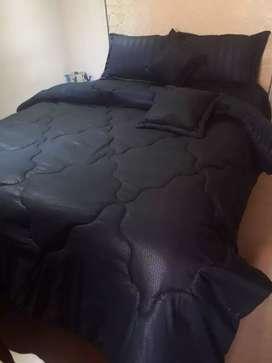 Edredon tipo plumon para cama doble en tela unicolor y estampada