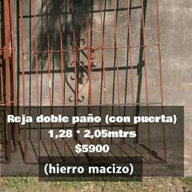 Reja de hierro macizo con puerta 1,28mtrs x 2,05mtrs