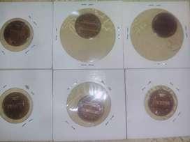 Monedas de Centavos con escudos torcidos