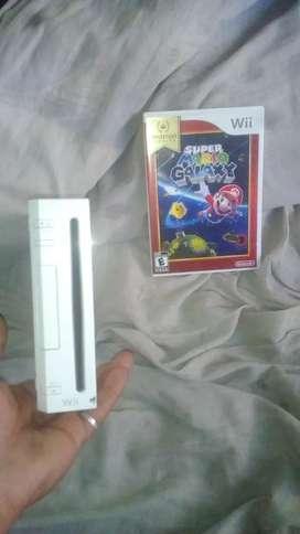 Consola wii y juego original.    Permuto