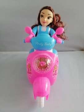 Muñeca en moto con luces