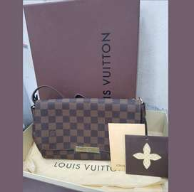 Se vende cartera Louis Vuitton