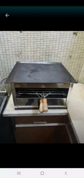 Vendo plancha, con calienta pan , impecable