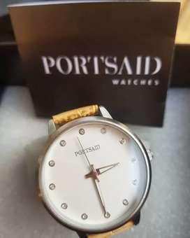 Vendo reloj Portsaid nuevo en caja y billetera Isadora