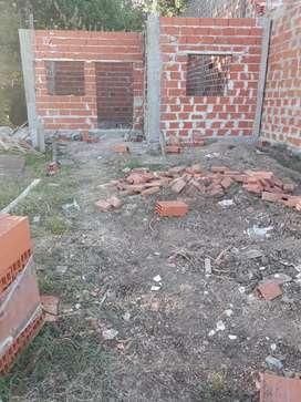 Vendo terreno con construcción a terminar Cuidad evita