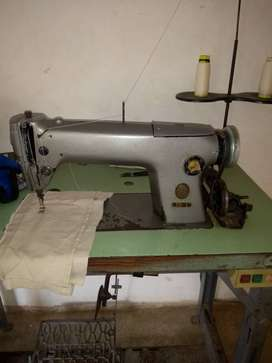 Máquina  de coser industrial planaa singer