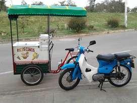 Moto con triciclo para venta de conos
