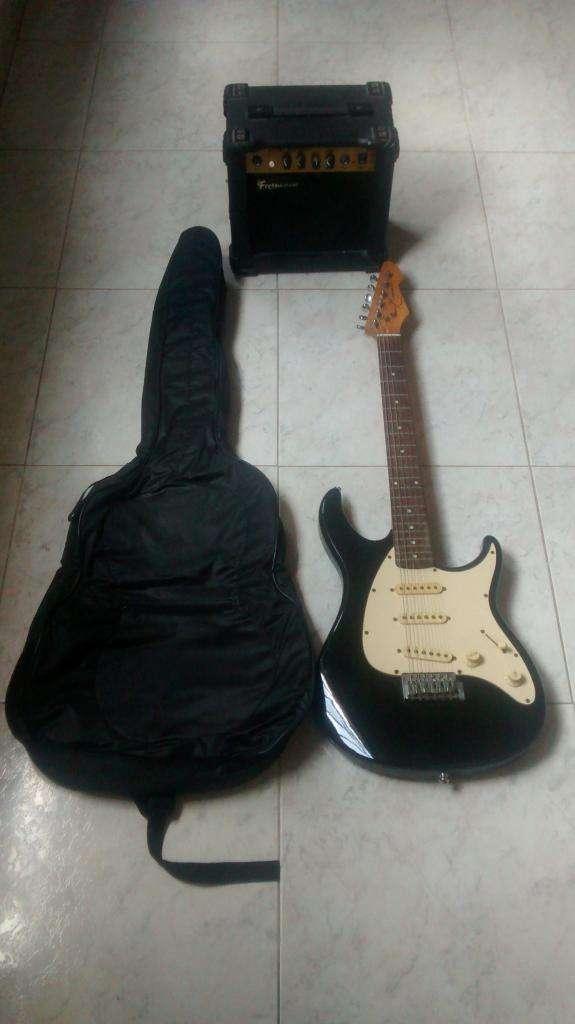 Guitarra peavey raptor exp y amplificador fretmaster 15 watts 0