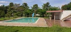 Lote 1 hectarea ,urbano con 3 casas y piscina