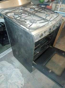 Vendo cocina con dos asaderas