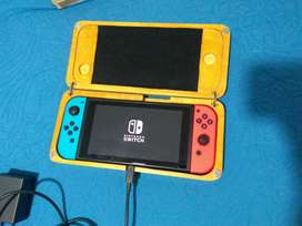 Nintendo switch con estuche de madera y accesorios