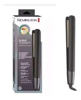 Plancha Remington Original recubrimiento de ceramica con micro acondicionadores de Coco