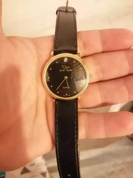 Reloj Oscar de la renta vendo o cambio