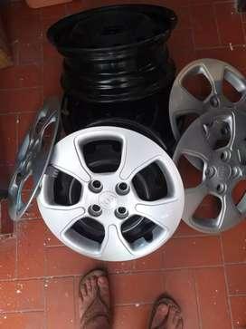 Se venden 4 rines nuevos de fabrica con sus tapas , para carro marca kia  Picanto