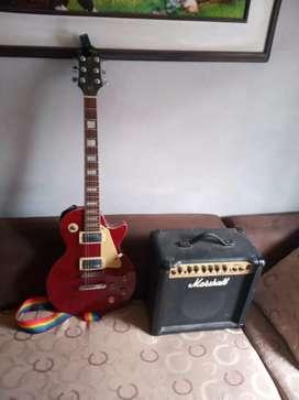 Vendo guitarra electrica lespoul edición Miami series de palmer y amplificación marshall