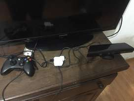 X Box 360 con juegos y un mando