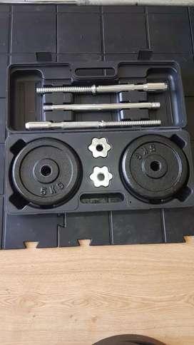 Barra desarmable para pesas con 20 kilos en discos y sus respectivos seguros
