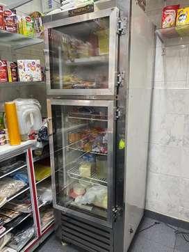 Nevera vertical mixta refrigera y congela