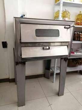 POR MOTIVO DE VIAJE se vende horno poco uso
