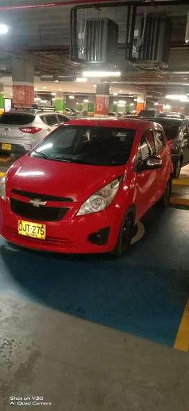 Se vende o permuta Chevrolet spark GT Rojo 2012