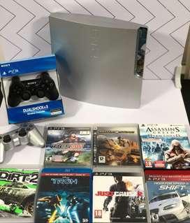 Play Station 3 - 160 GB - 2 Joystkic Inalámbricos (controles) - 7 juegos fisicos