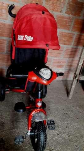 Vendo Triciclo Paseador con Musica Negoc