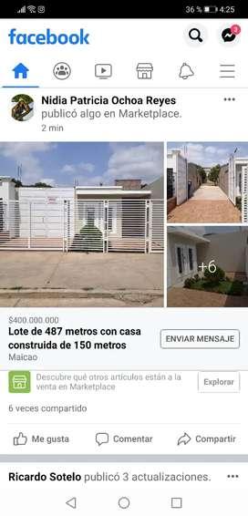 VENDO LOTE CON CASA CONTRUIDA y 2 LOCALES