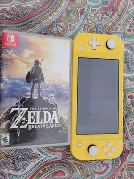 Nintendo switch LITE 9/10 cargador + 2 videojuegos